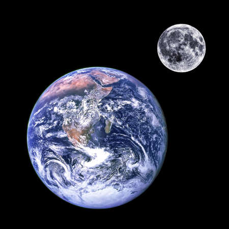 Manipulated nasa photographs of the earth and moon isolated together on a black background. photo