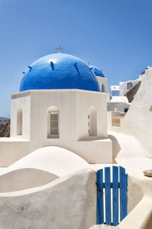 A view of a couple of the famous blue domed churches from Oia on the greek isle of Santorini. photo