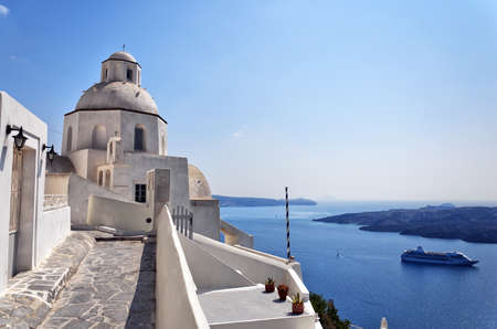 An image of a church in the santorini capital town of fira. photo