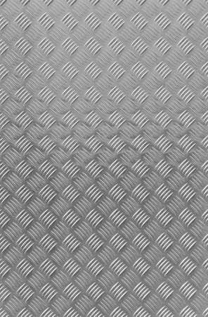 A shiny textured metal background with a corrugated pattern. photo