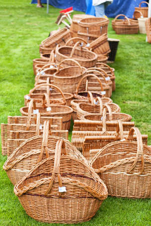 A selection of hand crafted wicker baskets for many uses. Shallow depth of field used with selective focus on the foreground region. Stock Photo - 10527015