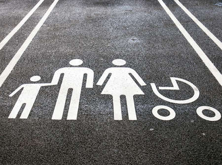 carpark: A designated parking spot at a supermarket intended only for families. Stock Photo