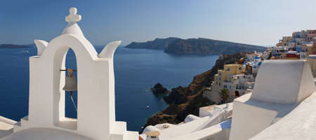 A panoramic image of the village of Oia on the greek island of Santorini. photo