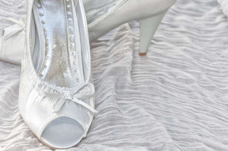 A pair of white shoes for a bride on her wedding day. photo