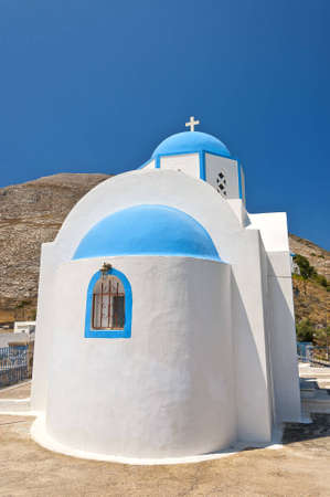 One of the many blue domed churches that adorn the greek island of santorini. photo