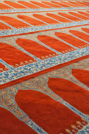 turkish rugs: The islamic styled carpet within the Suleiman mosque in Istanbul, Turkey. Stock Photo