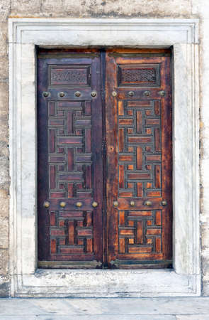 Old ornate wooden doors at the blue mosque in istanbul, Turkey. Stock Photo - 12079151