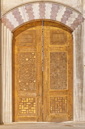 Old ornate wooden doors at the Suleiman mosque in istanbul, Turkey.