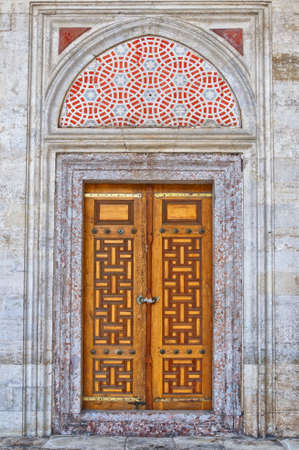 Old ornate wooden doors at the Sehzade mosque in istanbul, Turkey. Stock Photo - 12079150