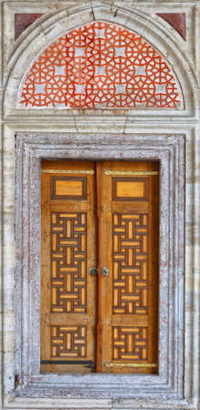 Old ornate wooden doors at the Sehzade mosque in istanbul, Turkey. photo