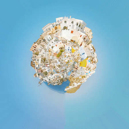 A panoramic image of the village of Oia on the greek island of Santorini made into the shape of a planet. photo