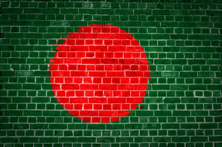An image of the Bangladesh flag painted on a brick wall in an urban location photo