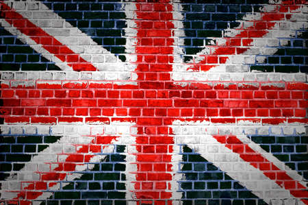 united kingdom: An image of the union jag flag painted on a brick wall in an urban location