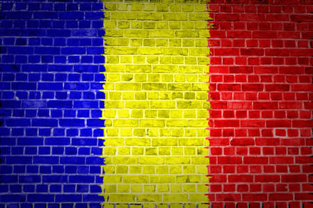 An image of the Chad flag painted on a brick wall in an urban location Stock Photo