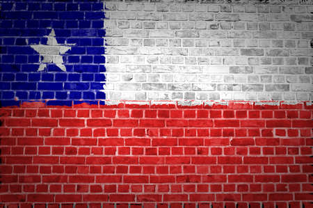 An image of the Chile flag painted on a brick wall in an urban location photo