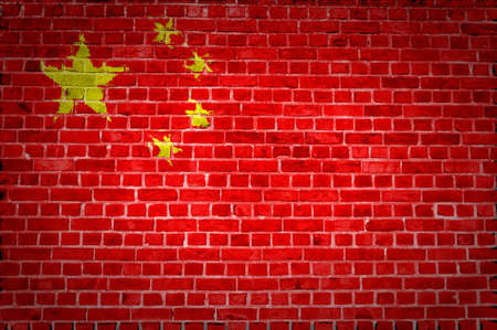 china flag: An image of the China flag painted on a brick wall in an urban location Stock Photo