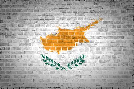 An image of the Cyprus flag painted on a brick wall in an urban location Stock Photo - 12422710