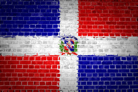 An image of the Dominican Republic flag painted on a brick wall in an urban location photo