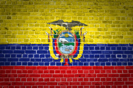 An image of the Ecuador flag painted on a brick wall in an urban location photo