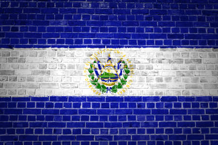 el salvador flag: An image of the El Salvador flag painted on a brick wall in an urban location