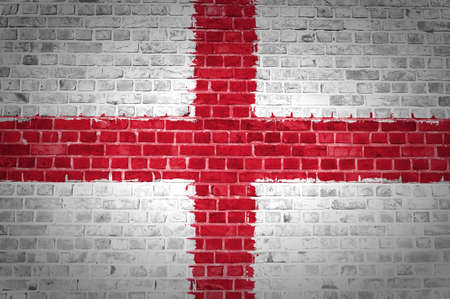 england flag: An image of the England flag painted on a brick wall in an urban location
