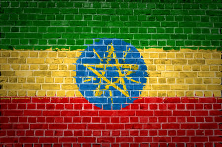 ethiopia abstract: An image of the Ethiopia flag painted on a brick wall in an urban location