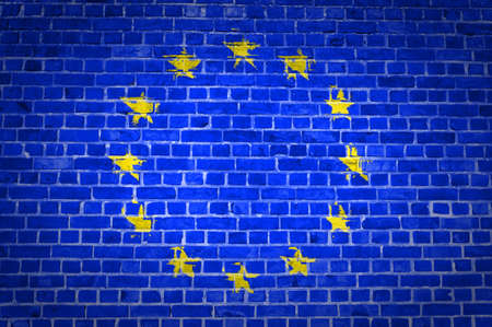 An image of the European Union flag painted on a brick wall in an urban location Stock Photo