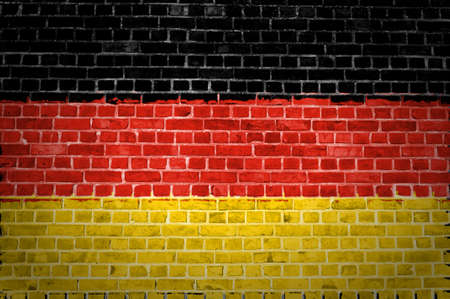 An image of the Germany flag painted on a brick wall in an urban location photo