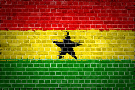 An image of the Ghana flag painted on a brick wall in an urban location Stock Photo