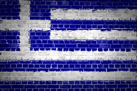 An image of the Greece flag painted on a brick wall in an urban location photo