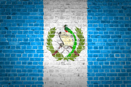 An image of the Guatemala flag painted on a brick wall in an urban location photo