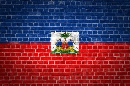 haiti: An image of the Haiti flag painted on a brick wall in an urban location Stock Photo