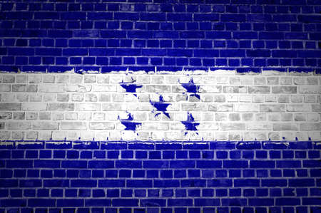 An image of the Honduras flag painted on a brick wall in an urban location Stock Photo - 12422724