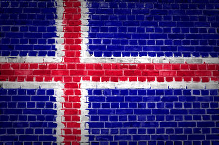 iceland flag: An image of the Iceland flag painted on a brick wall in an urban location Stock Photo