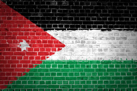 An image of the Jordan flag painted on a brick wall in an urban location Stock Photo - 12422703