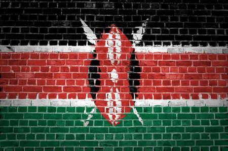 An image of the Kenya flag painted on a brick wall in an urban location photo