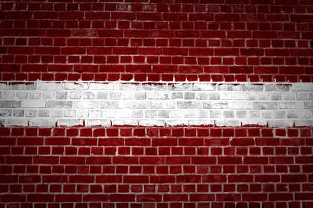 An image of the Latvia flag painted on a brick wall in an urban location Stock Photo - 12424738