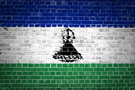 An image of the Lesotho flag painted on a brick wall in an urban location Stock Photo - 12422708