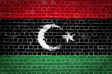 An image of the Libya flag painted on a brick wall in an urban location Stock Photo - 12422702