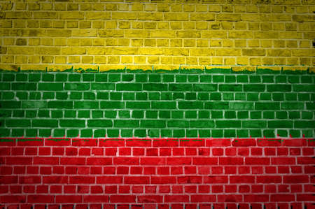An image of the Lithuania flag painted on a brick wall in an urban location photo