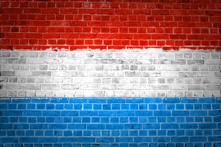 luxembourg: An image of the Luxembourg flag painted on a brick wall in an urban location