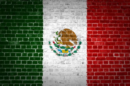 mexico city: An image of the Mexico flag painted on a brick wall in an urban location