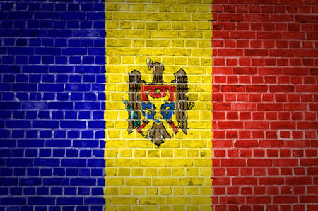 An image of the Moldova flag painted on a brick wall in an urban location Stock Photo - 12423190