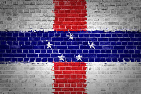 An image of the Netherlands Antilles flag painted on a brick wall in an urban location photo