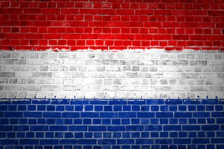 netherlands flag: An image of the Netherlands flag painted on a brick wall in an urban location