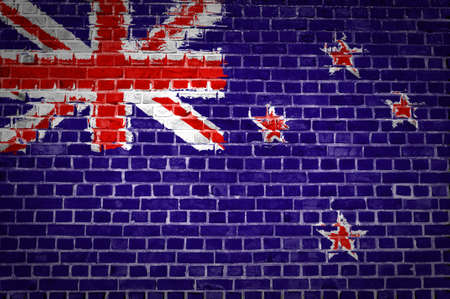 flag of new zealand: An image of the New Zealand flag painted on a brick wall in an urban location