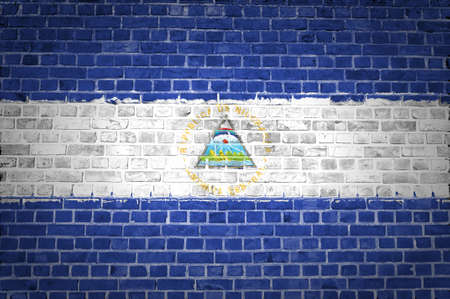 An image of the Nicaragua flag painted on a brick wall in an urban location photo