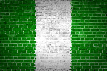 country nigeria: An image of the Nigeria flag painted on a brick wall in an urban location