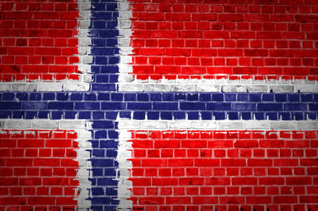 An image of the Norway flag painted on a brick wall in an urban location photo