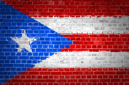 An image of the Puerto Rico flag painted on a brick wall in an urban location photo